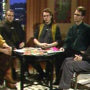 Liisa Pylkkäsen vetämässä keskusteluohjelmassa Kun mies haluaa miehen (1990) Hannu Puttonen, Mikko Roiha, Heikki Rausmaa, Jorma Hentilä.