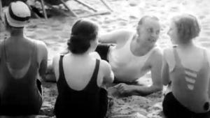Modesimdräkter på stranden