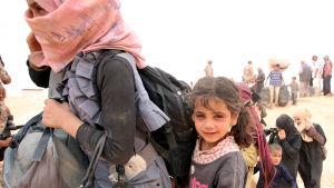 Syriska flyktingar från Aleppo-trakten anlände till ett jordanskt flyktingläger i maj 2016.
