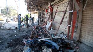 Bilbomb exploderade i stadsdelen Karrada i Bagdad, Irak den 2 juli 2016.