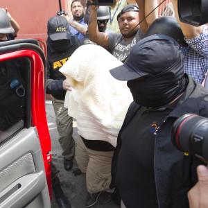 En av de fyra gripna som misstänks för mordet på Berta Caceres fördes till häktet av maskerade militärpoliser.