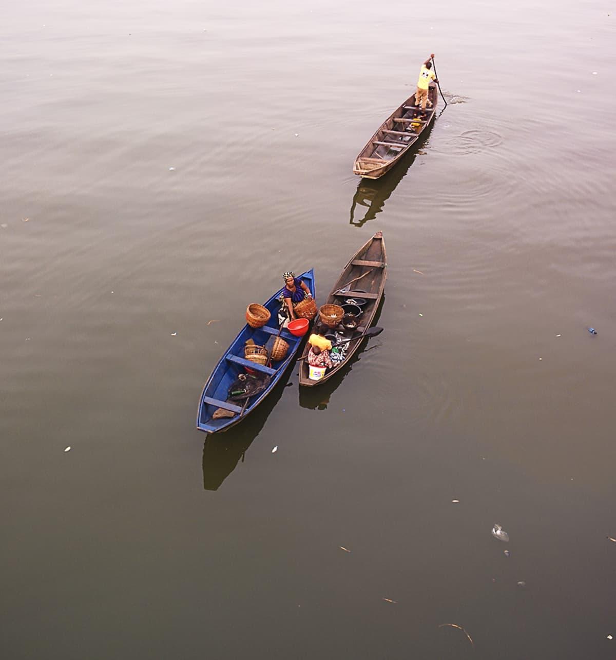 Hyttysten levittämät virukset lisääntyvät kuumissa ja kosteissa oloissa. Kalastajia Lagosin edustalla.