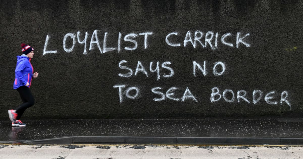 Anger at the Irish Sea Border and the Northern Ireland Protocol is rife in loyalist areas of Northern Ireland with graffiti like this example in Carrickfergus, County Antrim appearing on walls across the province.