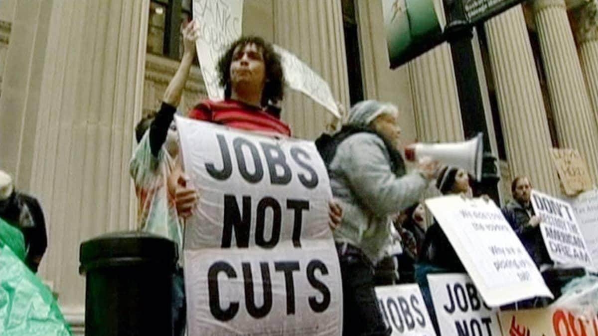 Mielenosoittaja Wall Streetillä New Yorkissa.