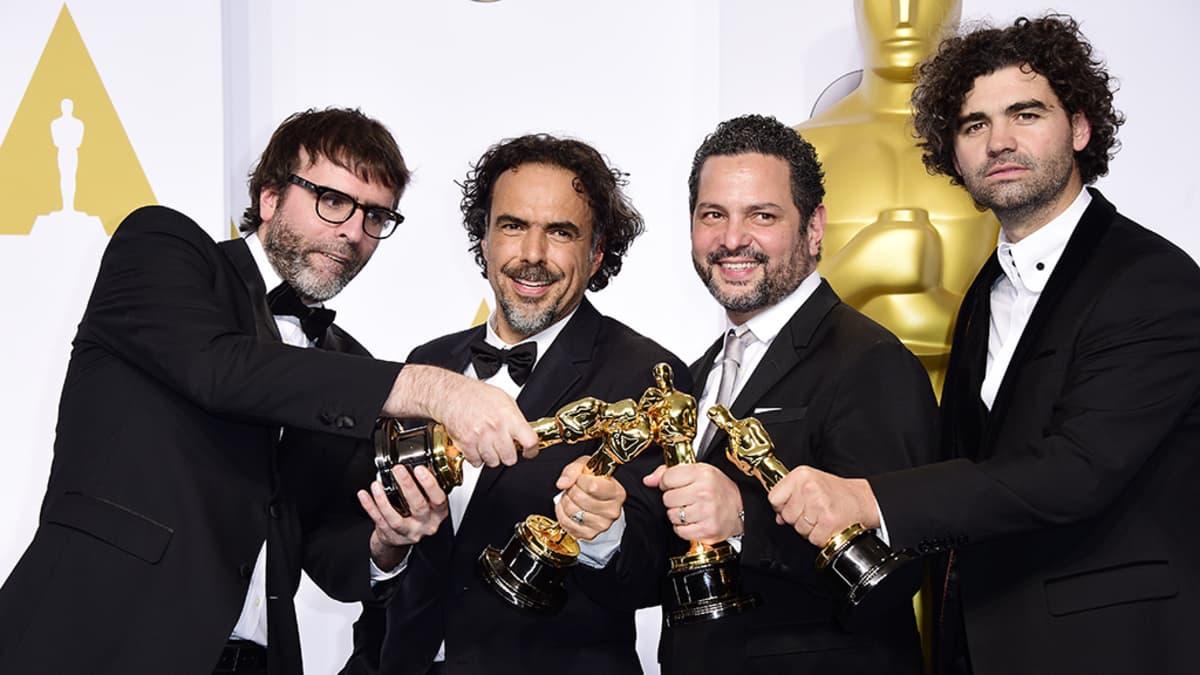 Nicolas Giacobone, Alejandro G. Inarritu, Alexander Dinelaris Jr. and Armando Bo