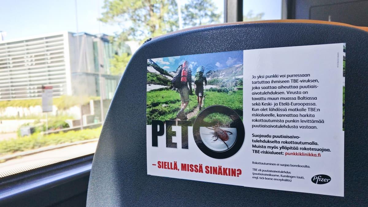 Pet-mainos bussissa.