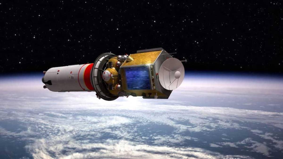 Putkilomainen raketti, jonka päässä mutterin muotoinen luotain. Ala näkyy Maan pilvinen pinta