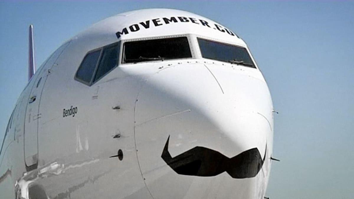 Qantas-lentoyhtiön viiksillä koristeltu kone Australiassa.