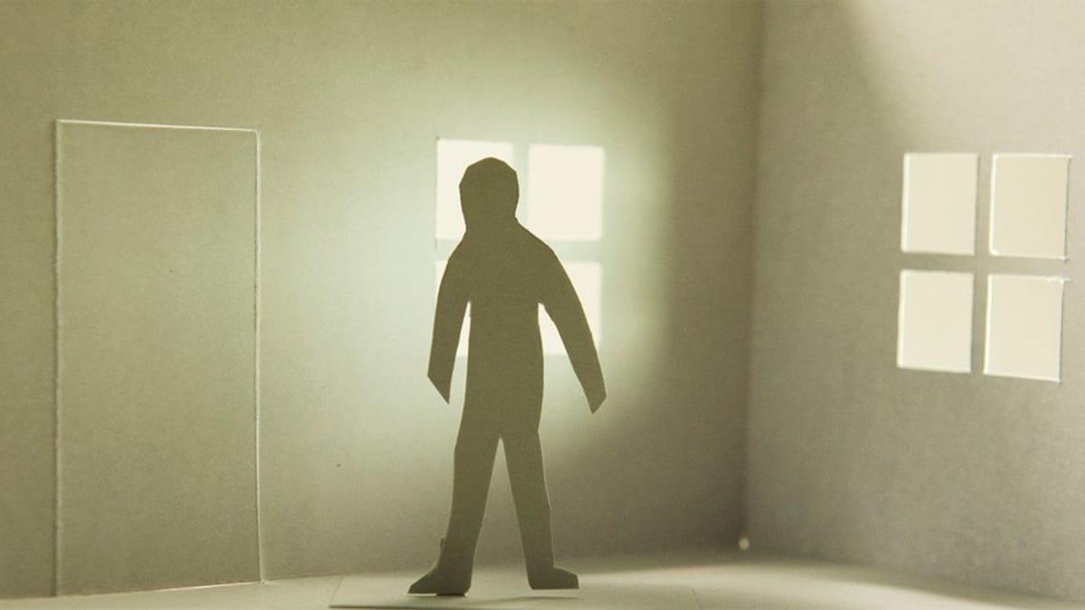 Yksinäinen paperinen ihmishahmo.