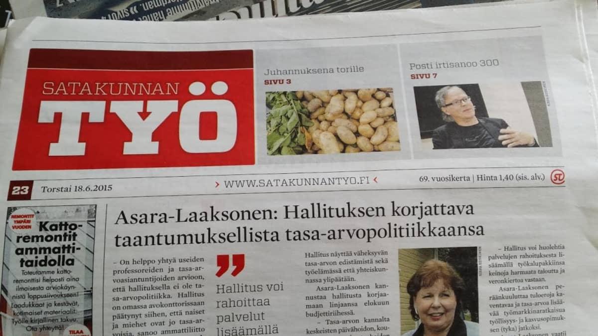 Pöydällä Satakunnan Työ -lehti.