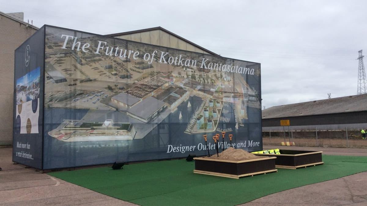 Suurikokoinen mainos Kotkan kantasatamaan rakennettavasta viihdekeskuksesta.