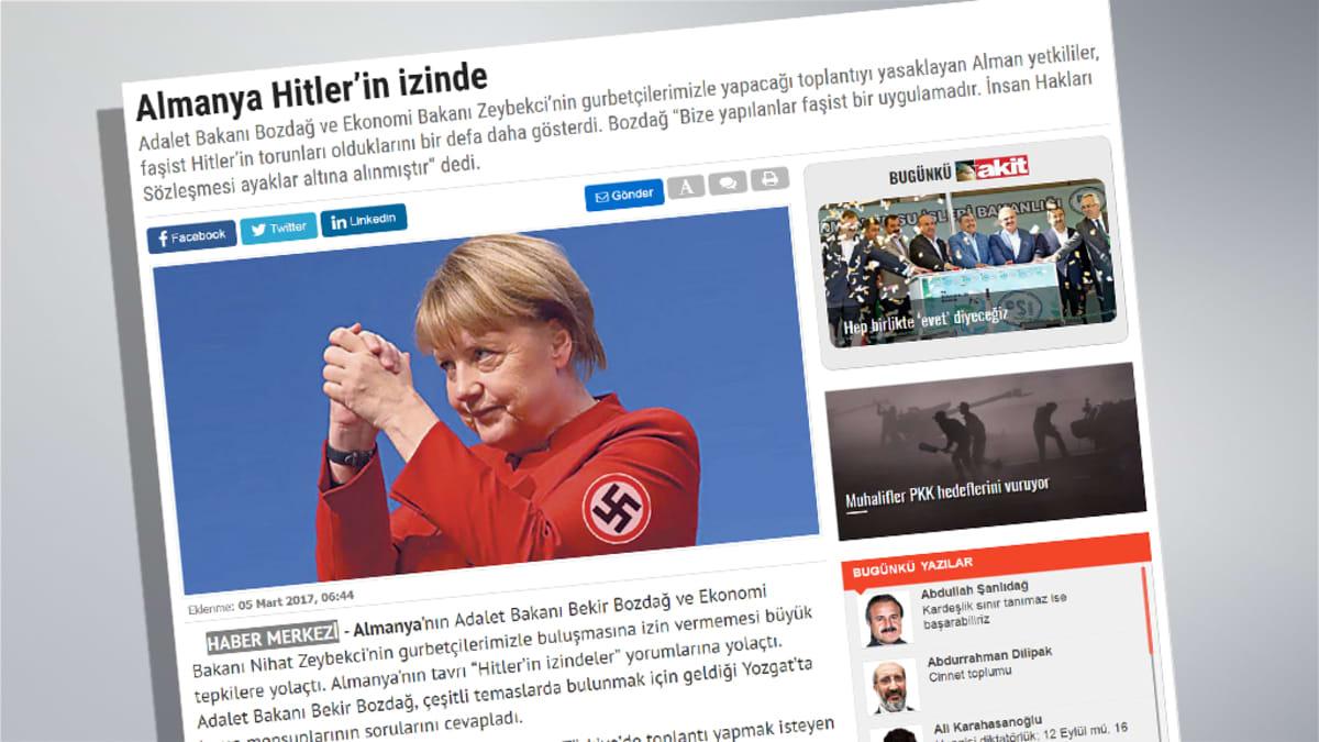 Angela Merkel hakaristi liepeessä.