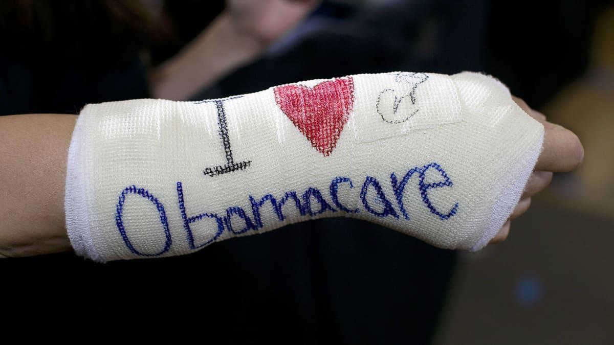 Obamacaren kannattaja kuvattuna Yhdysvaltain Massachusettsissa.