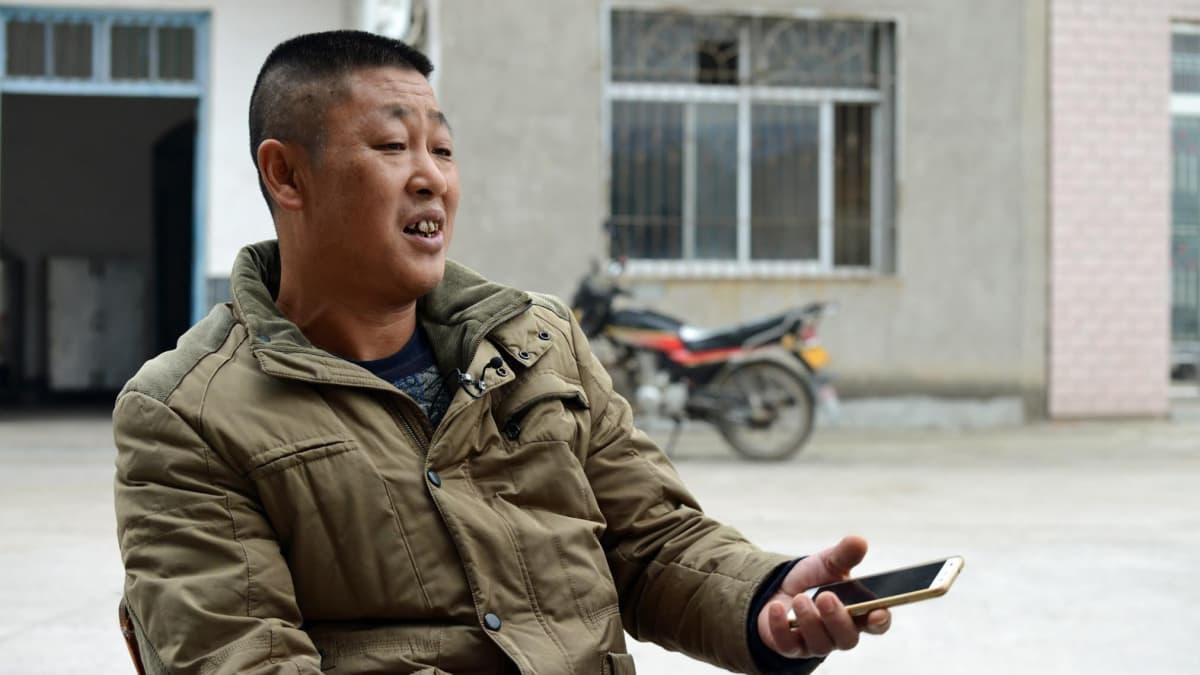 Wang Jiapein mukaan alku uudessa kylässä oli rankkaa, mutta hän on tyytyväinen valtion maksamiin korvauksiin.