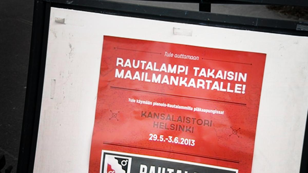 Rautalampip takaisin maailmankartalle -kyltti Helsingissä.