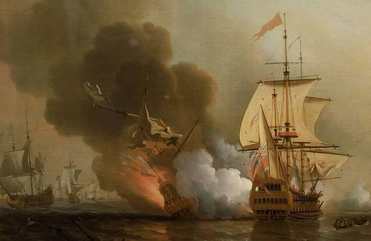Öljymaalaus liekkeihin räjähtäneestä aluksesta ja sitä ympäröivistä brittilaivaston purjelaivoista.