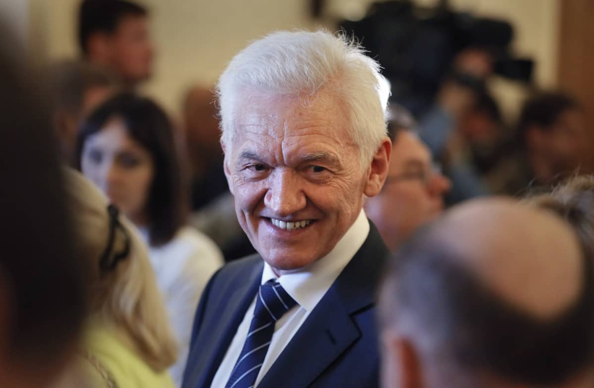 den ryska miljardären Gennadij Timtjenko ler.