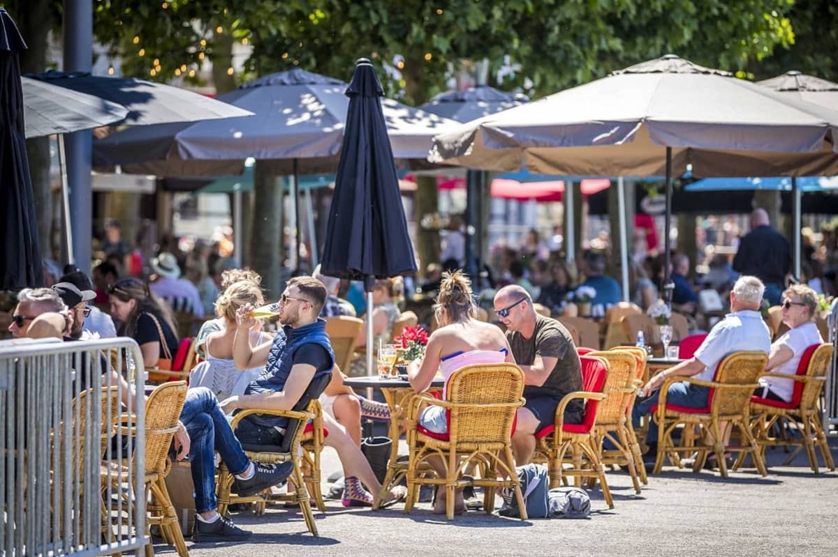 Guests on a terrace at the Vrijthof in Maastricht, The Netherlands, 01 June 2020. Measures to combat the spread of the COVID-19 coronavirus have been relaxed, which include the gathering of groups, catering, education and cultural institutions. EPA-EFE/MARCEL VAN HOORN