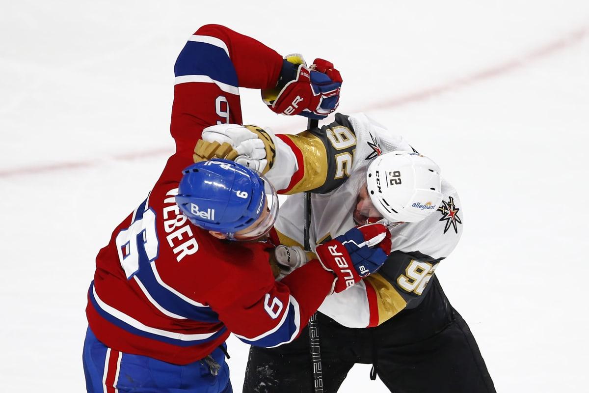 Tomas Nosek (oik.) ja Shea Weber tappalevat NHL-kaukalossa.