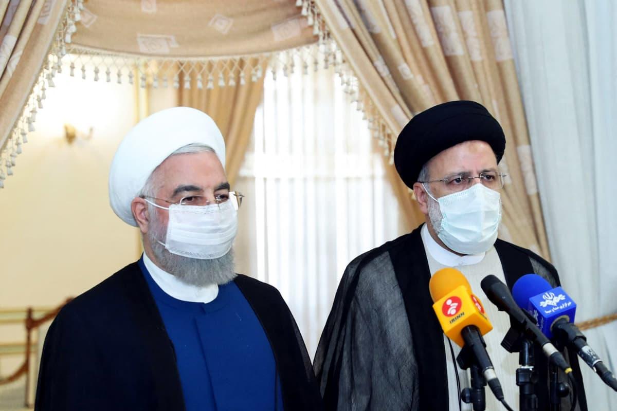 Hasan Ruhani ja Ebrahim Raisi