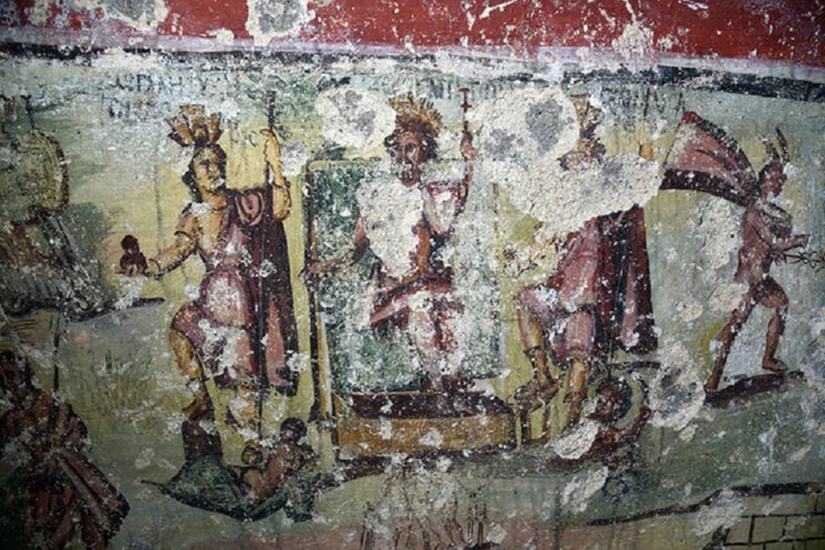 Zeus-jumala valtaistuimella, ympärillä kolme muuta jumalhahmoa.