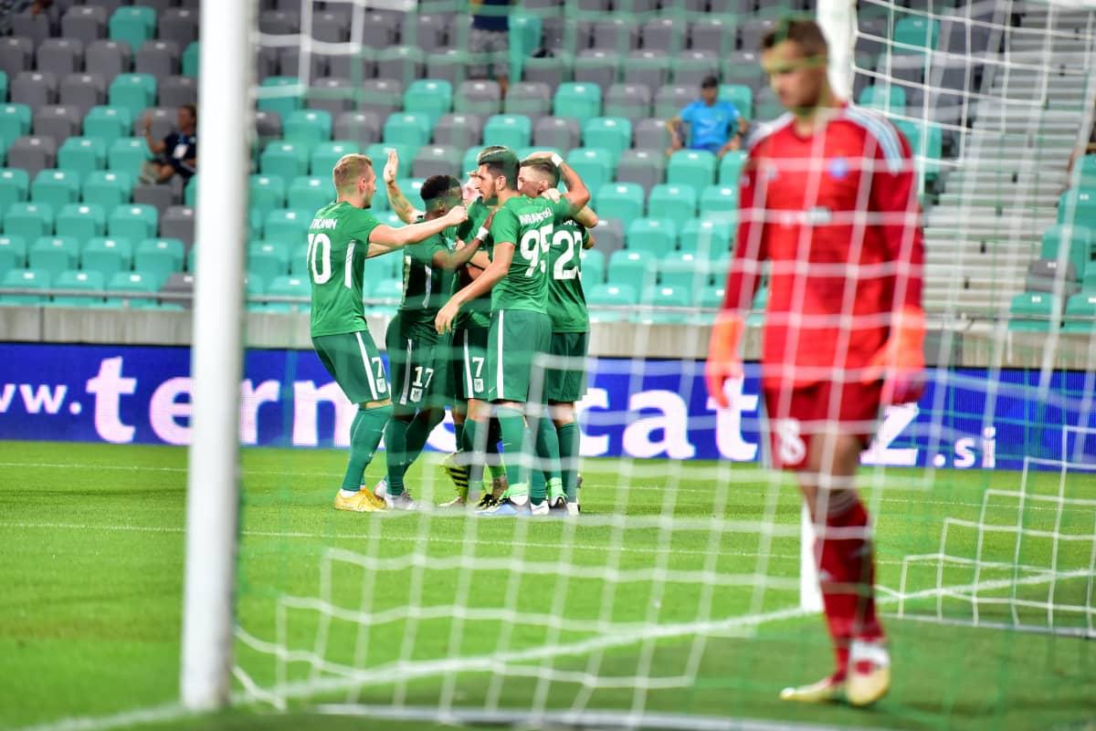 Olimpija juhlii, HJK:n Maksim Rudakov murjottaa.