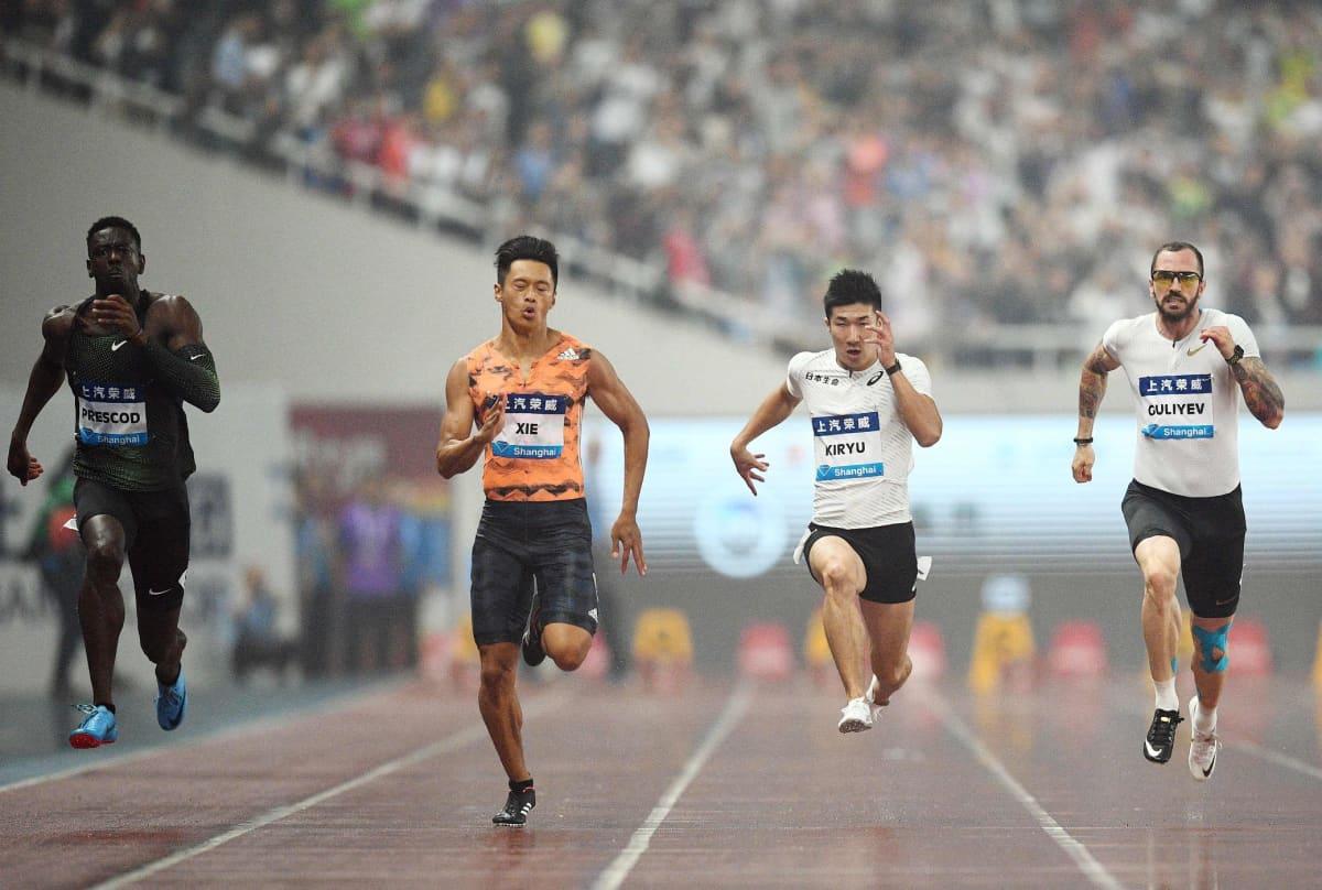 Reece Prescod (vas.), Xie Zhenye, Yoshihide Kiryu ja Ramil Guliyev Shanghain 100 metrin kisassa.