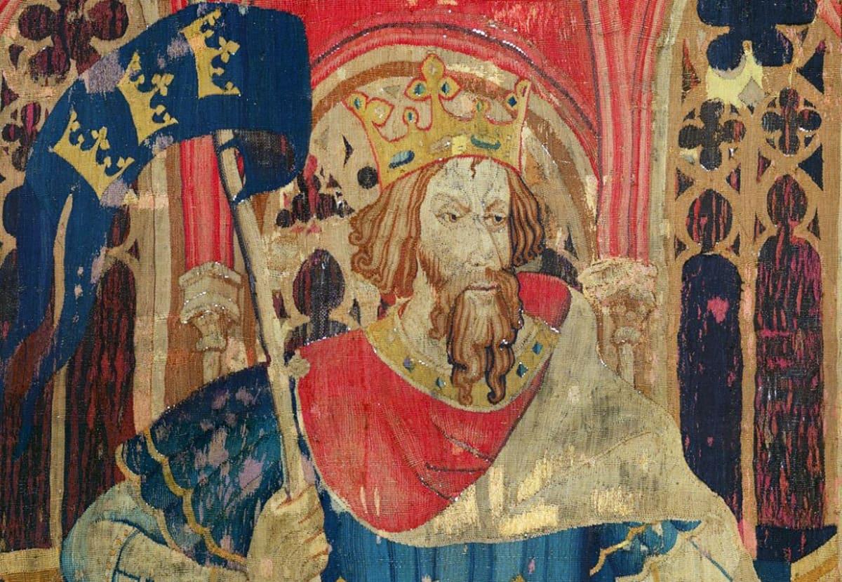 Lippua pitelevä kruunupäinen kuningas valtaistuimella.