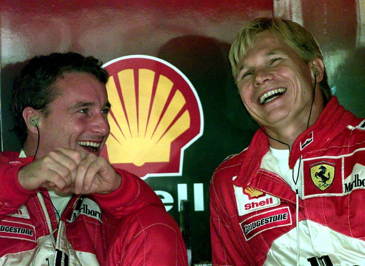 Ferrari-kuskit Mika Salo (oik.) ja Eddie Irvine vuonna 2009. (Arkistokuva)