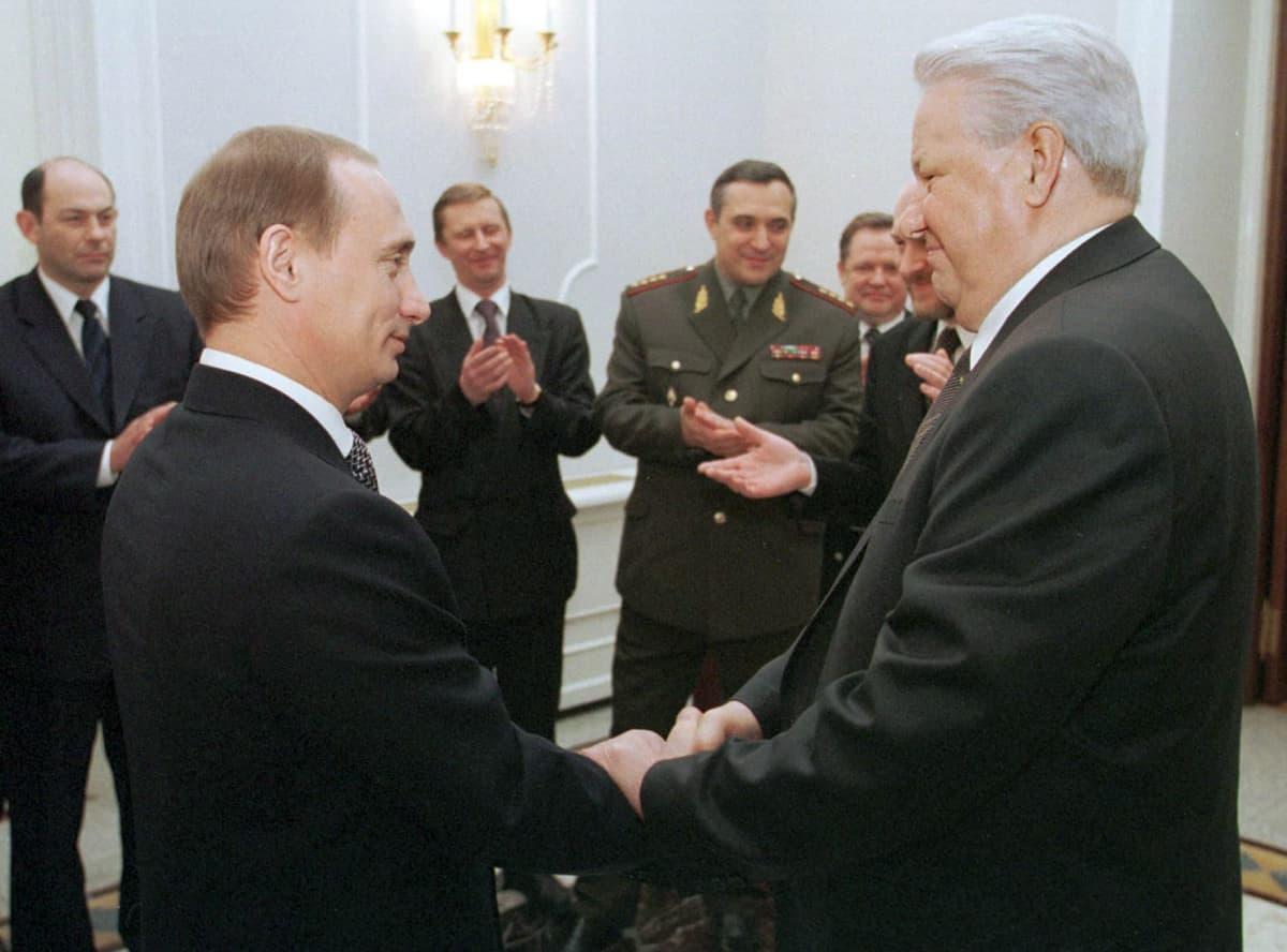 Vladimir Putin and Boris Jeltsin