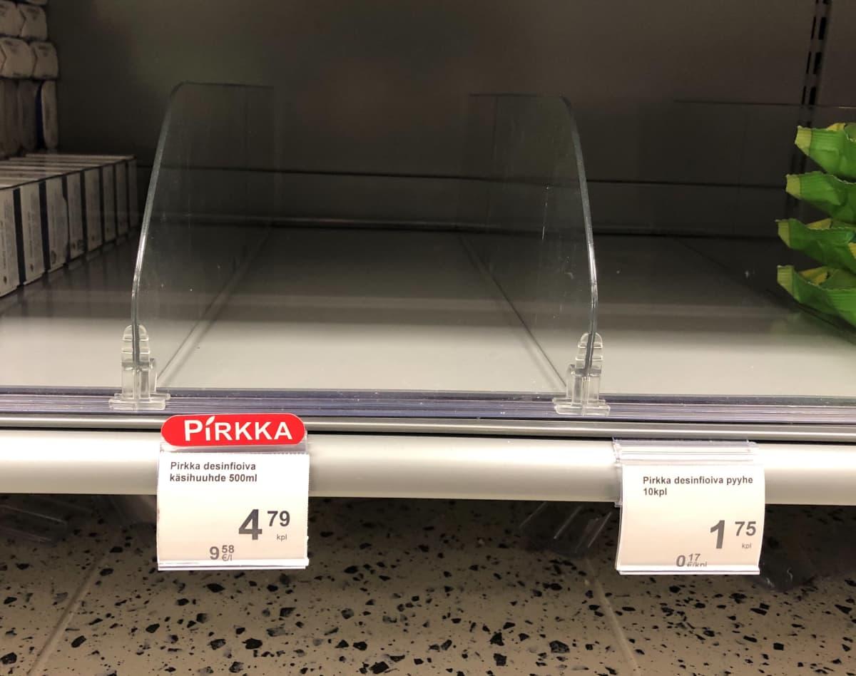 Tyhjä käsidesihylly K-market Kartanossa Lahdessa.