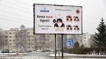 Maskinkäyttöön kehottava kyltti virolaisessa Maardun kaupungissa.