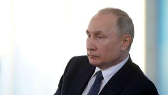 Venäjän presidentti Vladimir Putin Venäjän valtaamalla Krimin niemimaalla viime keväänä.