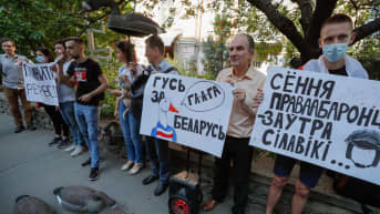 Belarusians living in Ukraine along with their supporters and Ukrainian activists hold placards and plastic gooses during a rally calling 'Goose for Belarus!', near the Belarus embassy in Kiev, Ukraine, 23 July 2021. According to protesters, they broug...