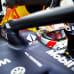 Red Bullin Max Verstappen hymyilee autostaan