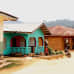 Vihreäksi maalattu talo seisoo Kamatahun Hassalassa nyt siinä, missä ihmisiä poltettiin elävältä sodan aikana. Koko kylä paloi sodan aikana maan tasalle, ja kaikki talot on rakennettu uudelleen.