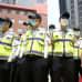 Eteläkorealaiset poliisit suojautuivat hengityssuojaimilla, kun mers-epidemia oli pahimmillaan kesäkuussa.