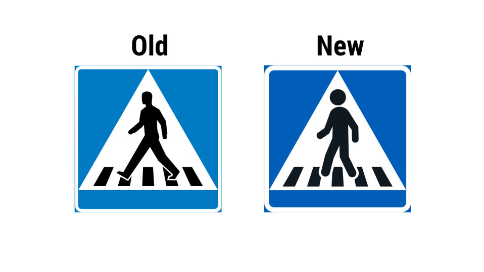 Old and new sign for pedestrian crossing